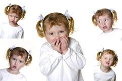Kleines Mädchen, das Gesichter bildet Stockbild