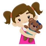 Kleines Mädchen, das ihren Teddy Bear umarmt Stockfotografie