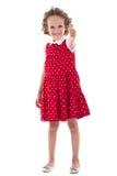 Kleines Mädchen, das oben Daumen gestikuliert Lizenzfreie Stockbilder