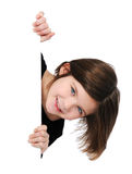 Kleines Mädchen, das unbelegtes Zeichen anhält Lizenzfreies Stockbild