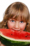 Kleines Mädchen, das Wassermelone isst Lizenzfreie Stockfotografie