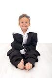 Kleines Mädchen in der großen Geschäftskleidung Stockfotos