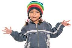 Kleines Mädchen der Mischrasse mit einer lustigen Haltung lizenzfreies stockfoto
