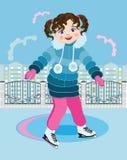 Kleines Mädchen an der Stadteisbahn Lizenzfreie Stockfotografie