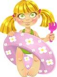 Kleines Mädchen in einem Badeanzug mit einem Schwimmenkreis Lizenzfreies Stockbild