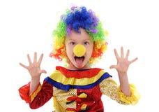Kleines Mädchen in einem Clownkostüm lizenzfreie stockbilder