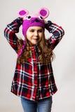 Kleines Mädchen in einer Hutmaus Stockfotografie