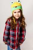 Kleines Mädchen in einer Schutzkappe Lizenzfreies Stockfoto