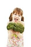 Kleines Mädchen geekelt mit Brokkoli stockfotos