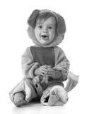 Kleines Mädchen gekleidet wie ein Welpe Stockbilder
