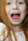 Kleines Mädchen-großer Mund stockfoto