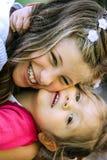 Kleines Mädchen an ihrem ersten Kommunion-Tag Stockfotografie