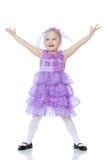 Kleines Mädchen im purpurroten Kleid Lizenzfreies Stockfoto