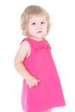 Kleines Mädchen im rosafarbenen Kleid Stockfotos
