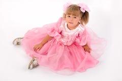 Kleines Mädchen im rosafarbenen Kleid Stockfotografie