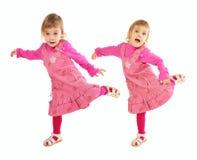 Kleines Mädchen im rosafarbenen Kleidtanzen Lizenzfreies Stockfoto
