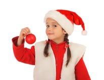 Kleines Mädchen im Weihnachtshut Lizenzfreies Stockbild