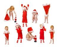 Kleines Mädchen im Weihnachtshut Lizenzfreies Stockfoto