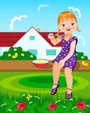 Kleines Mädchen isst Lizenzfreies Stockfoto