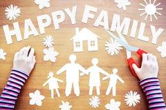Kleines Mädchen macht Zusammensetzung über glückliche Familie Lizenzfreies Stockbild