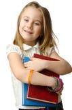 Kleines Mädchen mit Büchern lizenzfreie stockbilder