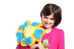 Kleines Mädchen mit Blume Stockfotografie