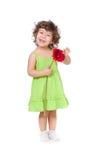 Kleines Mädchen mit Blume des afrikanischen Gänseblümchens auf Weiß Lizenzfreie Stockfotografie