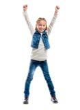 Kleines Mädchen mit dem Daumen oben Stockbild