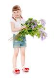 Kleines Mädchen mit einem Blumenstrauß der Blumen Lizenzfreies Stockfoto