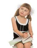 Kleines Mädchen mit einem Buch Stockbilder