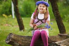 Kleines Mädchen mit einem Chaplet Lizenzfreies Stockbild