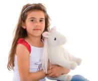 Kleines Mädchen mit einem Pferd Lizenzfreie Stockfotografie