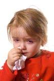 Kleines Mädchen mit einer strengen Grippe Stockfoto