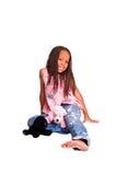 Kleines Mädchen mit Flechten Stockfotos