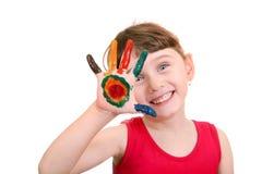 Kleines Mädchen mit gemalter Palme Stockbilder
