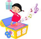 Kleines Mädchen mit Geschenkkasten Stockfoto