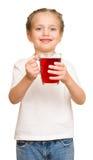 Kleines Mädchen mit Glas Saft Lizenzfreie Stockfotografie