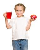 Kleines Mädchen mit Glas Saft Stockfotografie