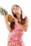 Kleines Mädchen mit großer Ananas Lizenzfreie Stockfotografie