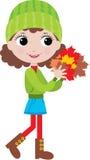 Kleines Mädchen mit Herbstblättern Lizenzfreies Stockfoto