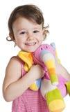 Kleines Mädchen mit ihrem Spielzeugelefanten Lizenzfreie Stockbilder