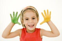 Kleines Mädchen mit ihren Händen gemalt Lizenzfreies Stockbild