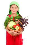 Kleines Mädchen mit Korb des Gemüses Lizenzfreie Stockbilder