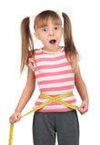 Kleines Mädchen mit Maß lizenzfreie stockfotografie