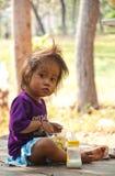 Kleines Mädchen mit Milch Lizenzfreie Stockfotos