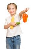 Kleines Mädchen mit Obst und Gemüse auf Weiß Stockbild