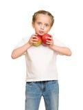 Kleines Mädchen mit Obst und Gemüse auf Weiß Stockfotos