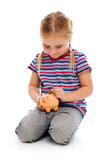 Kleines Mädchen mit piggy Querneigung Stockfotos