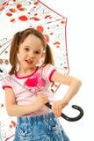 Kleines Mädchen mit Regenschirm Stockfoto