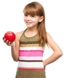Kleines Mädchen mit rotem Apfel Lizenzfreie Stockfotografie